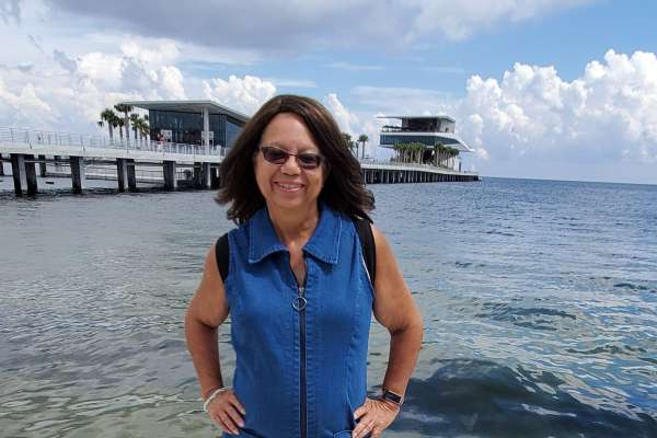 photo of Emily Taylor-Snell in front of the water with a pier in the background