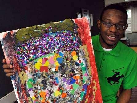 Teen Winfield Holds Up Artwork he created