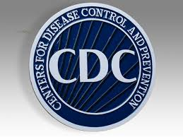 logo shows the white letters C D C in the center of a dark blue circle with the words centers for disease control and prevention around the perimeter of the circle