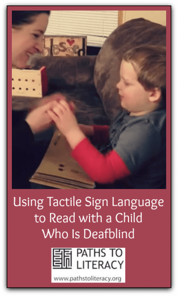Image of adult and child using tactile sign over an open book