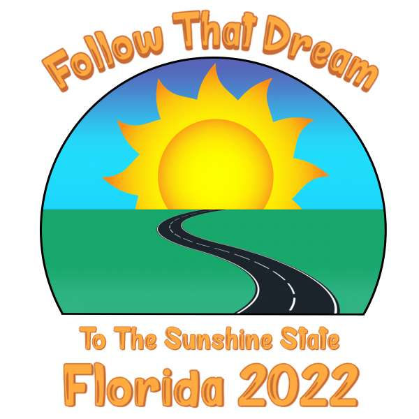"""The image shows a blck road on green grass leading towards a yellow sun on the horizon in a blue sky.  Text above the image reads """"Follow That Dream"""" and text below the image reads, """"To The Sunshine State, Florida 2022"""""""